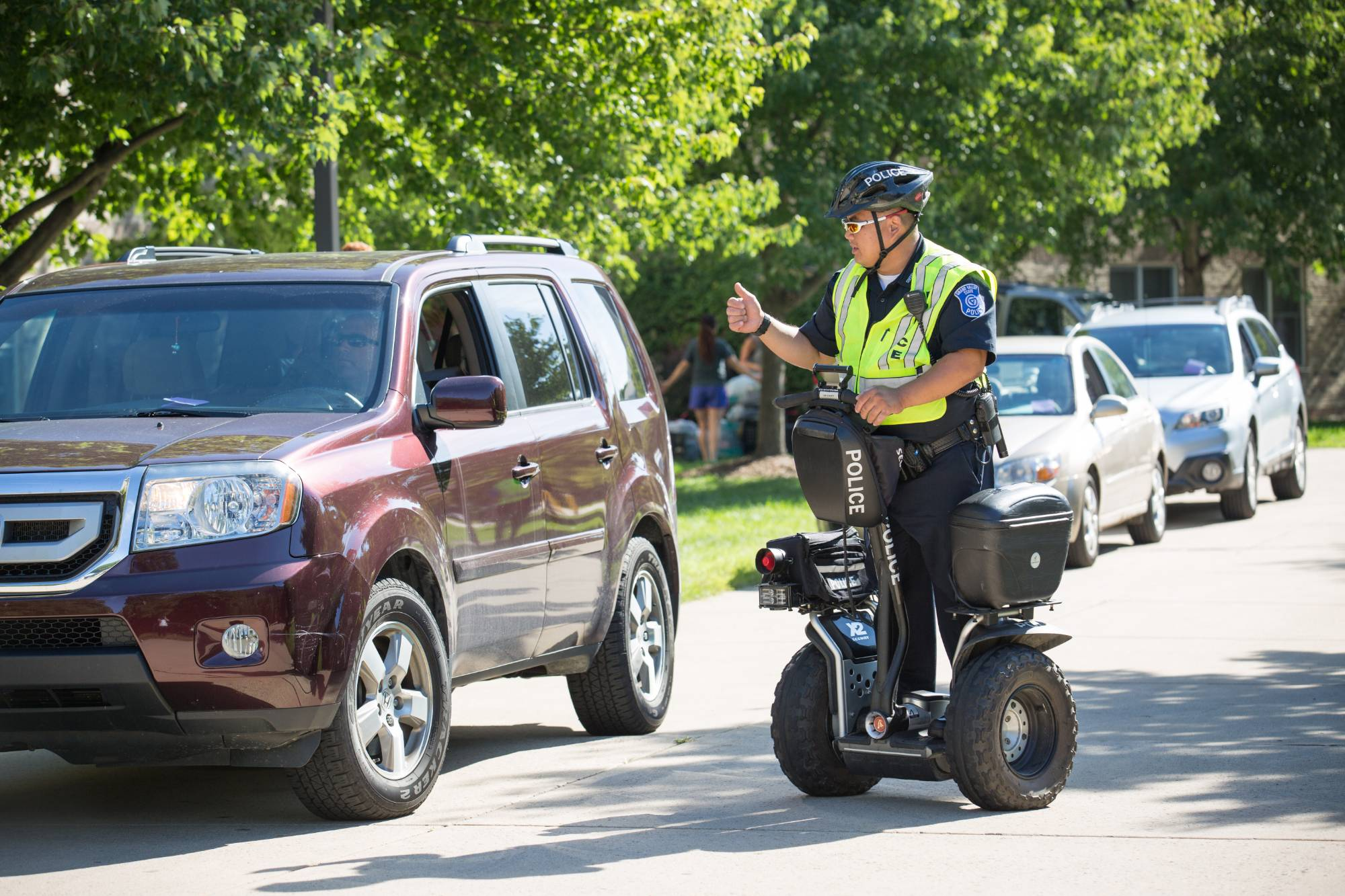 Image of GVSU Police Department member navigating traffic on move-in day